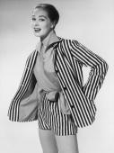 A woman modelling a striped summer shorts suit with a wraparound blouse