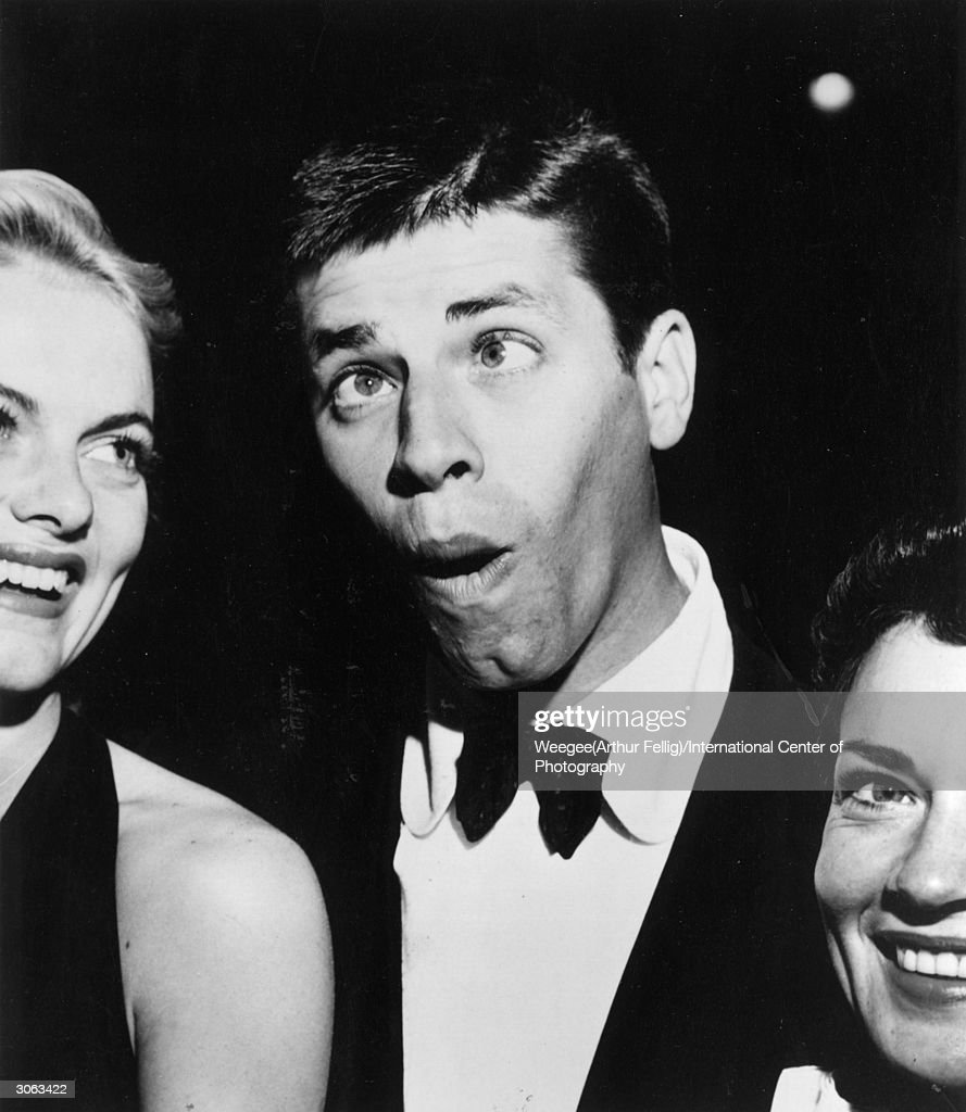 American actor and slapstick comedian <a gi-track='captionPersonalityLinkClicked' href=/galleries/search?phrase=Jerry+Lewis+-+Comedian&family=editorial&specificpeople=202947 ng-click='$event.stopPropagation()'>Jerry Lewis</a> with his friends in Hollywood, California. (Photo by Weegee(Arthur Fellig)/International Center of Photography/Getty Images)