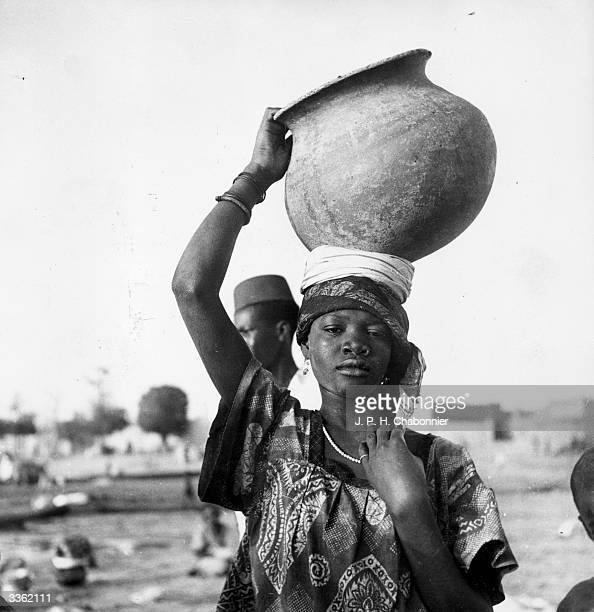 An African woman carrying an earthenware pot to Gao in Mali Africa