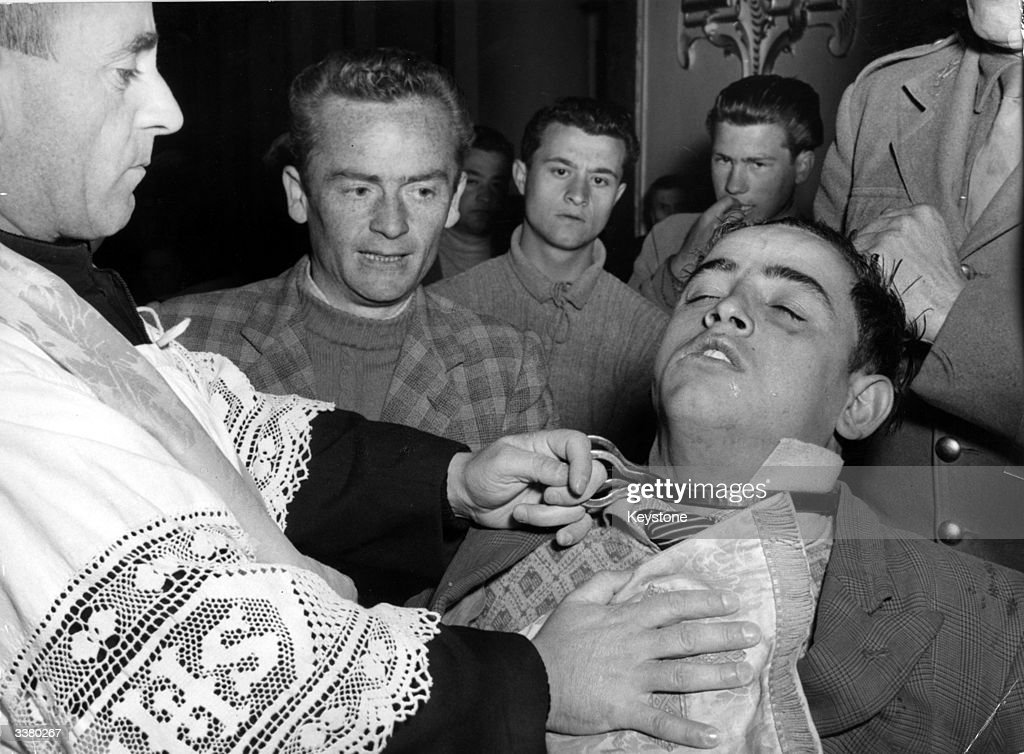 An Italian priest performs an exorcism on a man who has been placed in a trance The neck of the sick man is fenced in by the penitentring of Saint...