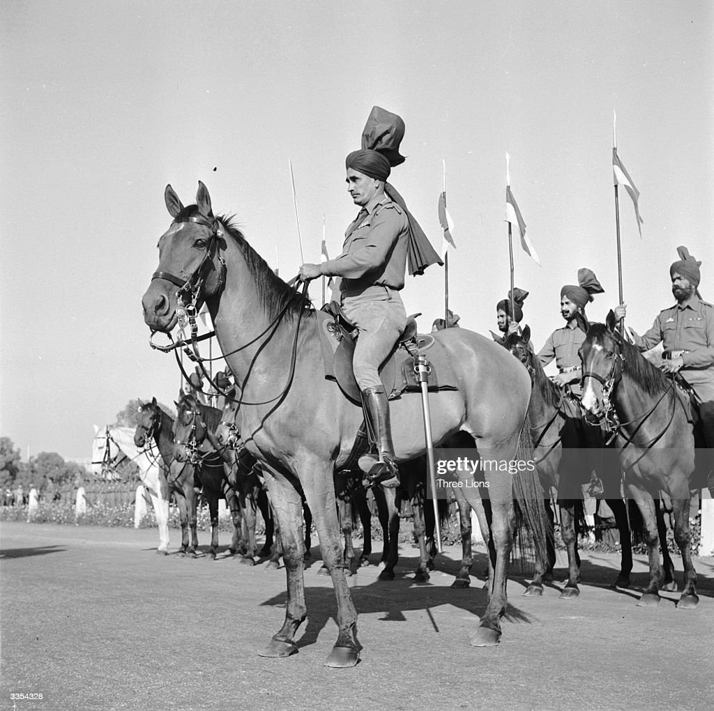 An officer of the Bengal Lancers with his unusual turban sits at the head of his mounted troops.