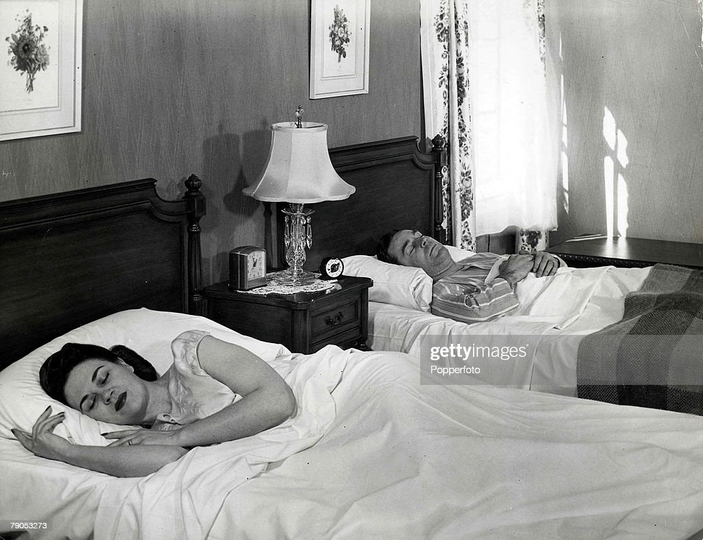 Classic Collection Page 119 A man and woman in separate beds asleep