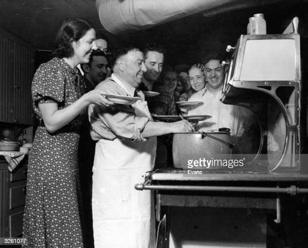 Father Lprinzi serves up spaghetti to his large family