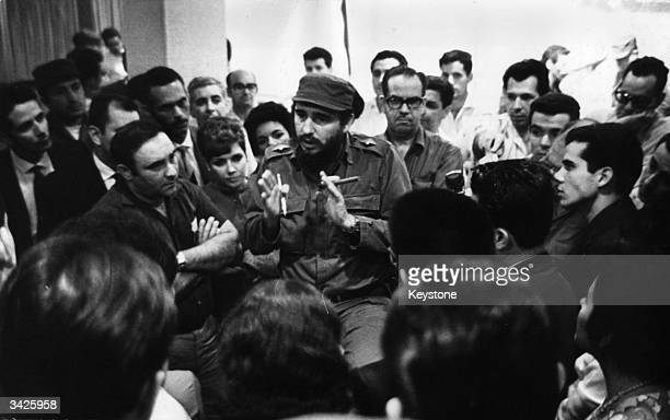 Fidel Castro and Osvaldo Dorticos Torrado talking to Cuban medical staff who are going to Peru to help with the aftermath of an earthquake