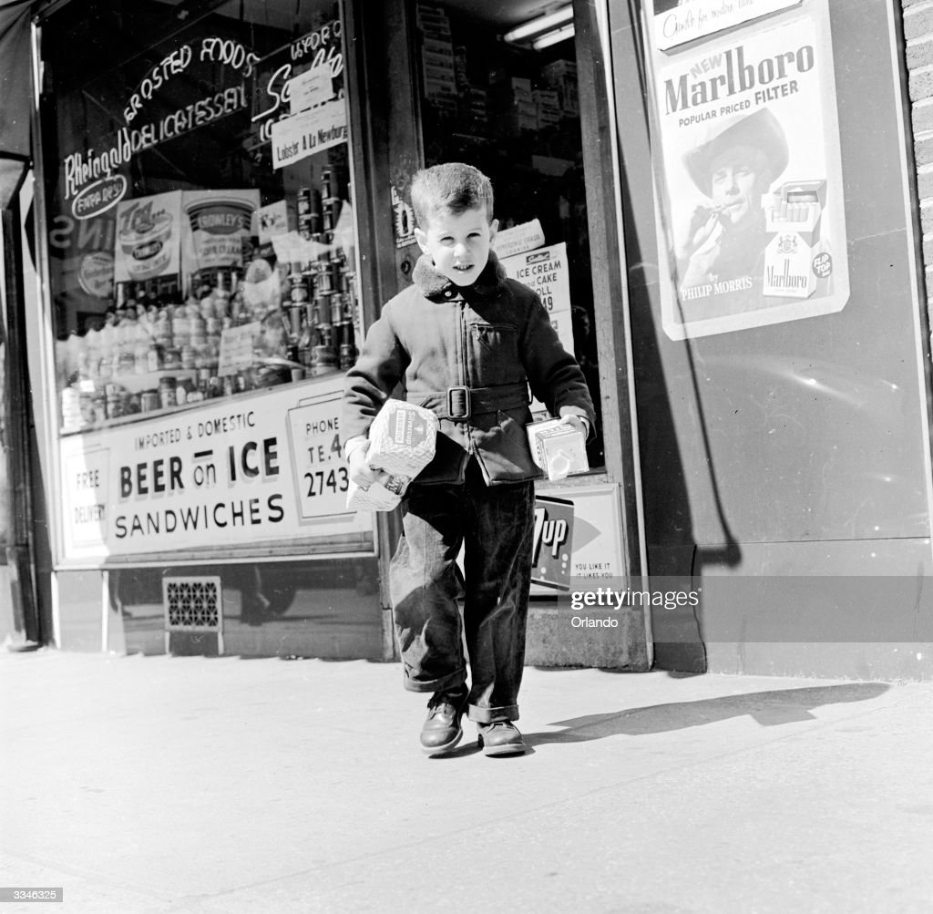 Five year old Morgan Layton from Larchmount New York leaves the grocers en route home with bread and milk