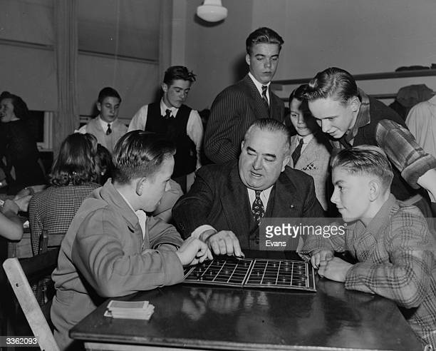 Mayor Edward Biertuempfl of Union City plays checkers with Frank Zunarz and Louis Wenisch at the Union City Youth Club