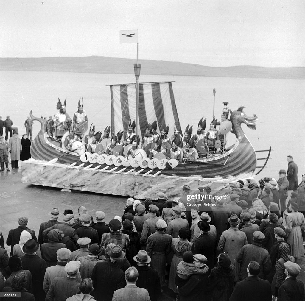 Members of the Lerwick 'UpHellyAa' committee aboard their unlaunched replica of a Norse galley during annual celebrations commemorating the...