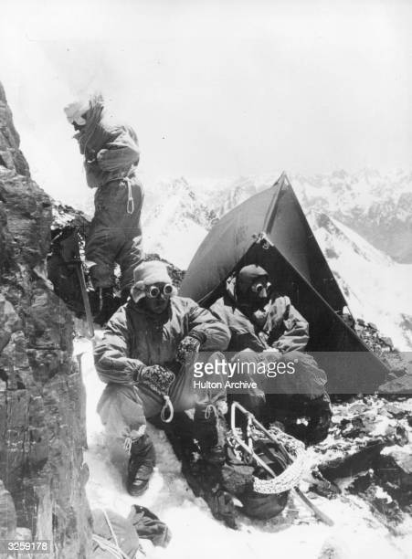 Mountaineers bivouac at the foot of K2 waiting for better weather