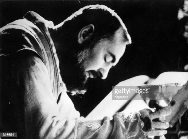 Mystic and Stigmatic Capuchin friar Padre Pio celebrating mass The stigmata on his hands can be seen He bears on his body the five marks of the...
