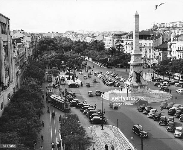 Parked cars around the monument in the Square of the Restorers Lisbon