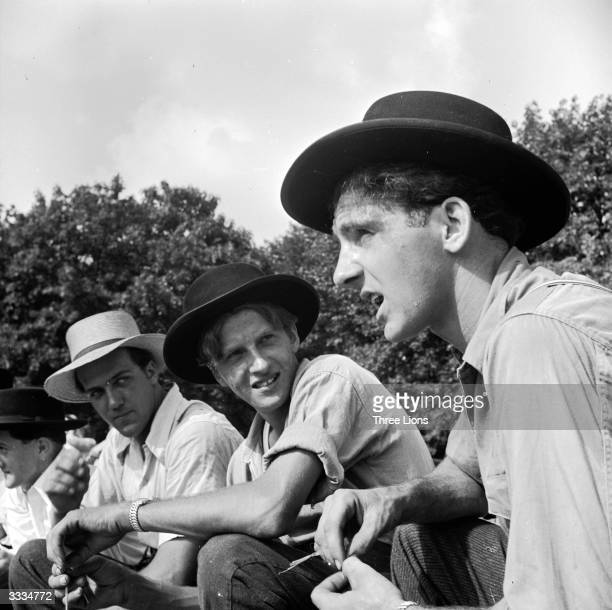 The Amish are one of the strictest of the American Mennonite sects Men and male youths will always wear their broadbrimmed hats in public