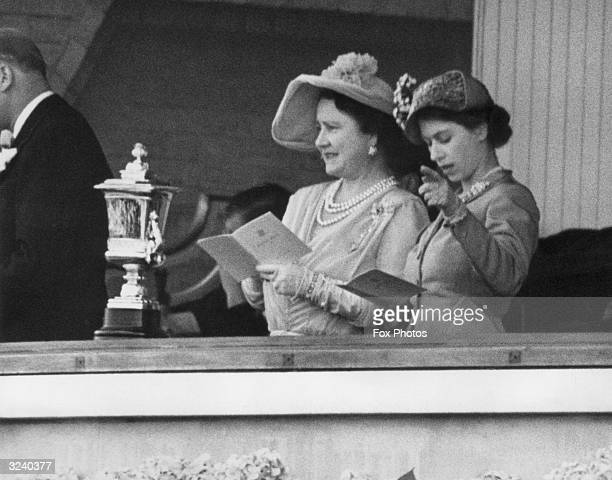The Queen and Princess Elizabeth studying the form guide on the first day of Ascot