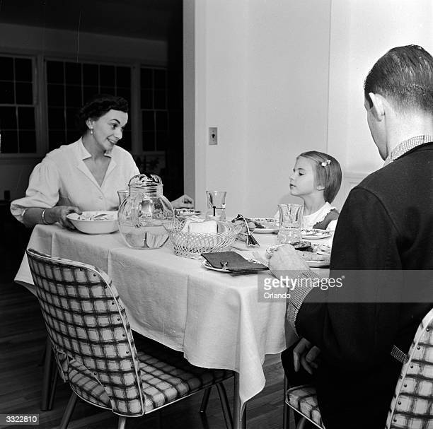The Simonson family settle down for dinner together in Connecticut USA