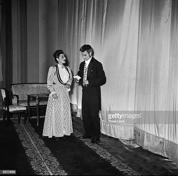 Two actors from a production of Oscar Wilde's play 'Lady Windemere's Fan' talk backstage at the Theatre Saadi in Tehran