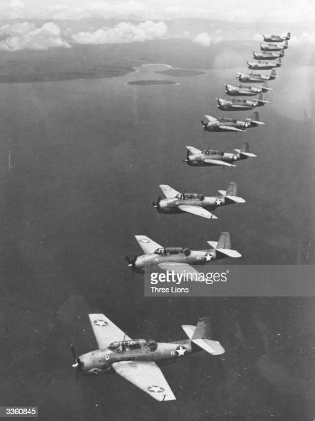 US Navy 'Avenger' torpedo bombers flying in formation during a patrol over a Southwest Pacific island base