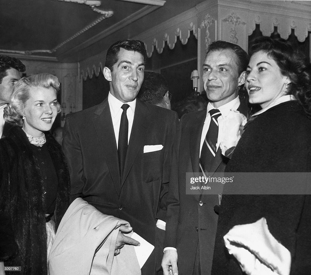 Jeanne Biegger with her husband, actor Dean Martin (1917 - 1995), and actor and singer Frank Sinatra (1915 - 1998) with his wife, actor Ava Gardner (1922 - 1990). Biegger and Gardner were Martin and Sinatra's second wives; Sinatra was Gardner's third husband.