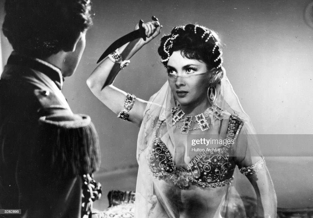 Gina Lollobrigida, the Italian glamour girl and leading lady is with Gerard Philipe (1922 - 1959) the French actor in a scene from the film 'Les Belles De Nuit' about a discontented teacher who dreams of beautiful women through the ages. The film was directed by Rene Clair for Franco London / Rizzoli.