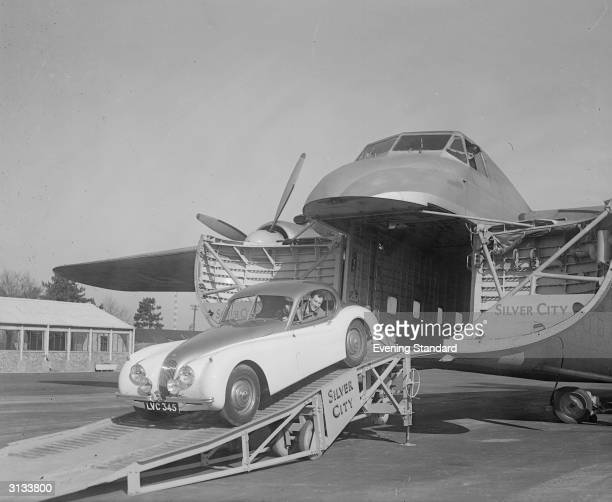 On the ramp of a Silver City cargo plane Stirling Moss driving a Jaguar XK120
