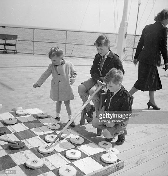 Robert Gerald and Keith Allum playing a game of deck draughts on the pier at Bournemouth Dorset