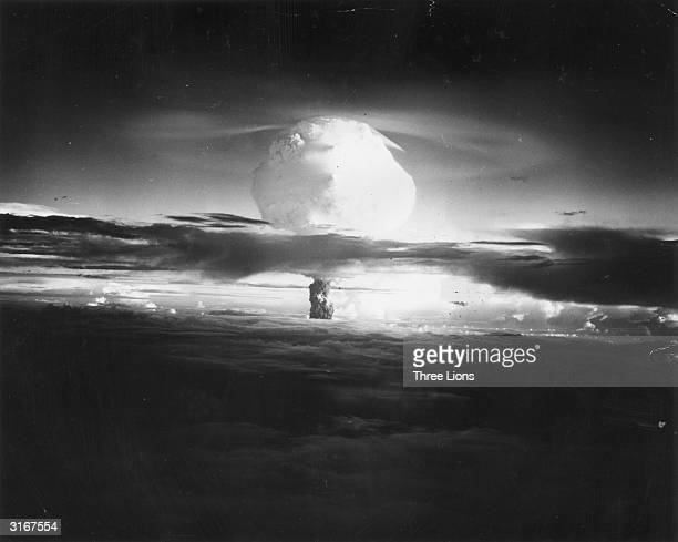 The mushroom cloud of fire and smoke rises 40000 feet in two minutes after the Hydrogen Bomb explosion at Eniwetok Atoll in the Pacific