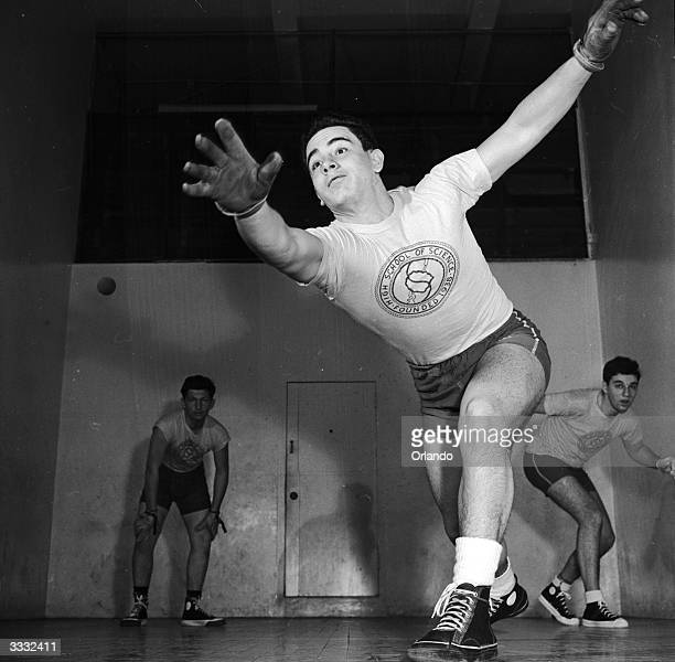 Bronx High School of Science students playing handball at Bronx YMCA New York City The hard rubber ball requires the players to wear gloves or suffer...
