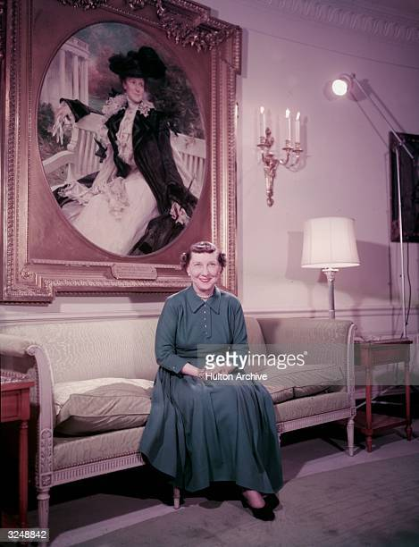 First Lady Mamie Eisenhower wife of President Dwight D Eisenhower 34th President of the United States sits in front of a painted portrait of Edith...