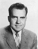 Studio headshot portrait of American vice president Richard Nixon wearing a jacket and tie
