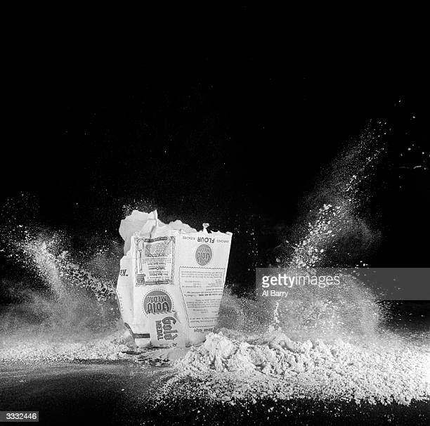 A bag of flour bomb is dropped from a height of six feet and seems to explode up landing