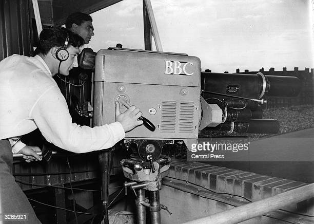 A BBC television cameraman at work at the Oval cricket ground London