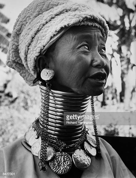 A Burmese woman wearing thick brass coils to lengthen her neck