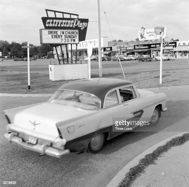 A car entering a Candian shopping mall's car park for a drivein church service in Scarborough Ontario Canada