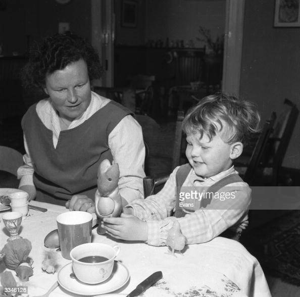 A child at the Easter breakfast table finds the traditional bread bunny or 'Pass Haasje' holding a hard boiled egg
