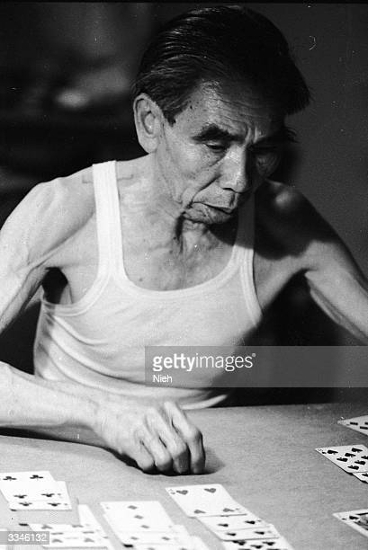 A Chinese man plays solitaire
