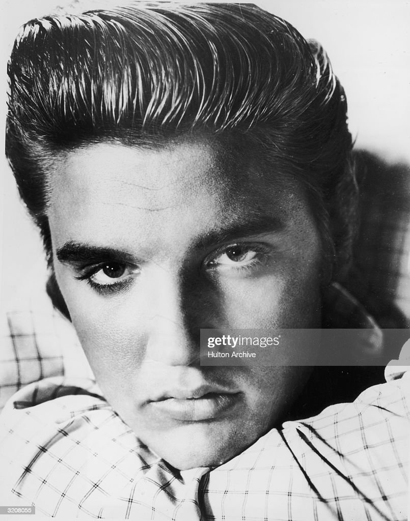 A closeup portrait of American rock and roll musician <a gi-track='captionPersonalityLinkClicked' href=/galleries/search?phrase=Elvis+Presley&family=editorial&specificpeople=67209 ng-click='$event.stopPropagation()'>Elvis Presley</a> (1935 - 1977).
