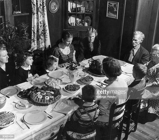A family in Kentucky saying grace before their christmas dinner