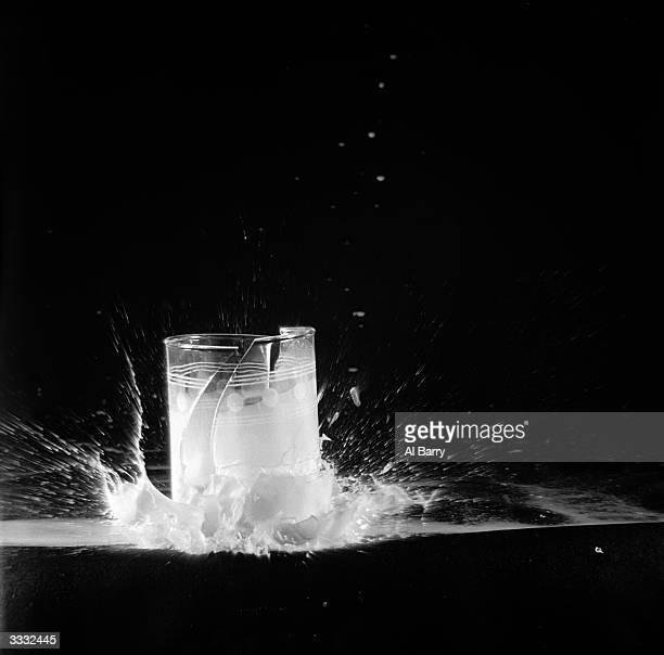 A glass of milk is dropped from a height of six feet The glass shatters from the bottom where the weight is suddenly concentrated