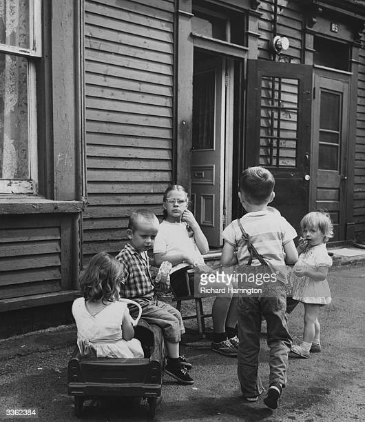 A group of children outside their house in St Johns Newfoundland