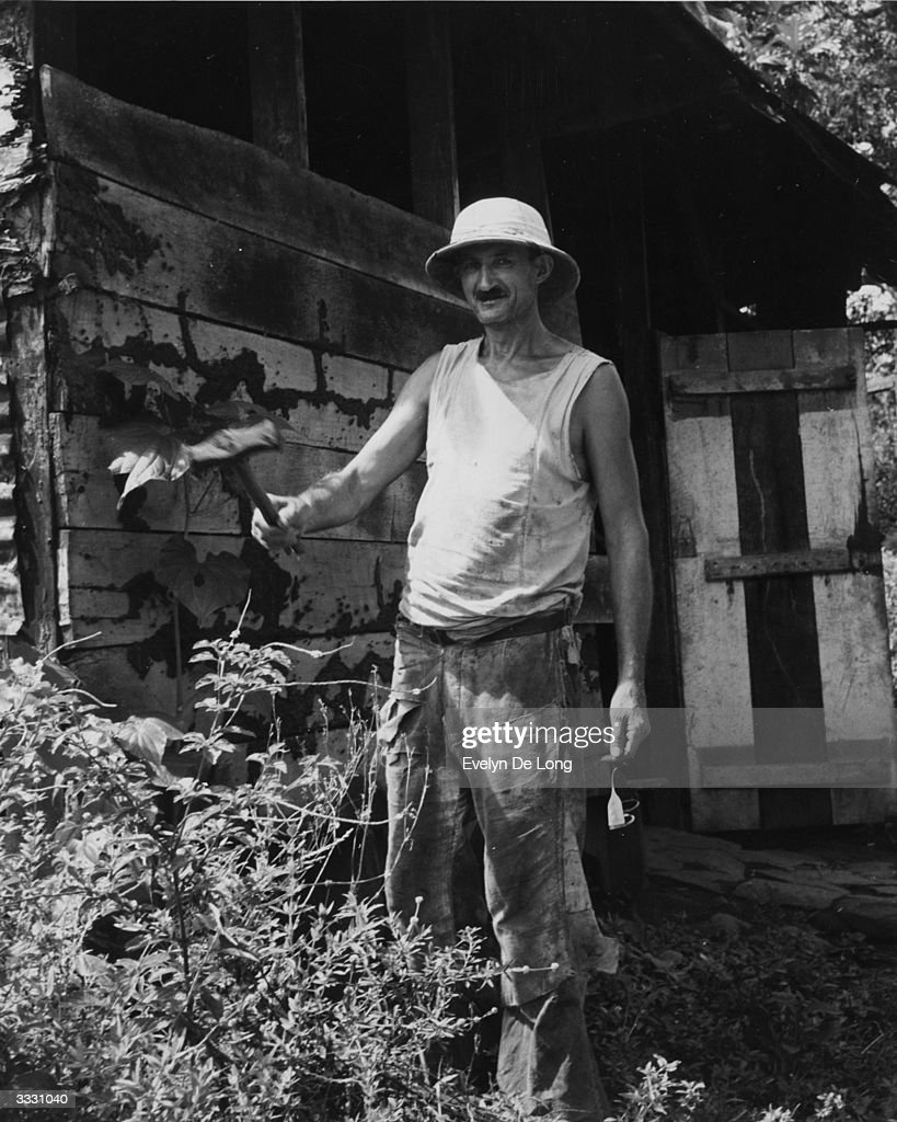 A 'Libere' tends his vegetable garden near Cayenne. He is one of hundreds of French criminals living as free men in the French colony of Guiana. Having served their sentences on the penal colony at Devil's Island, most are either too poor, or unwilling to buy a return passage to France.