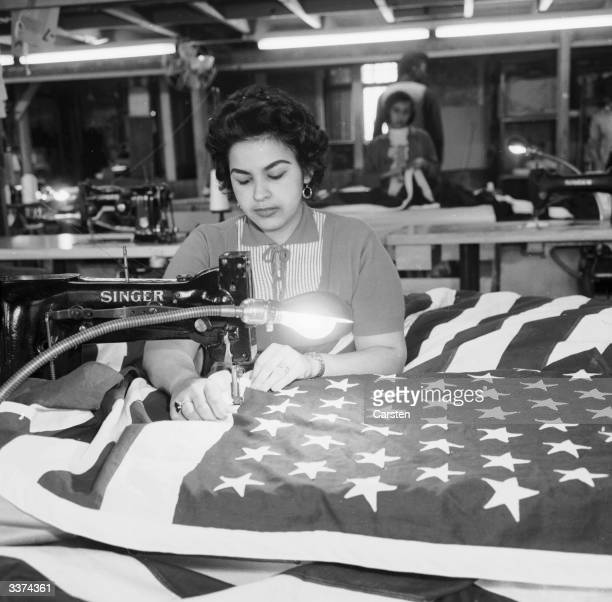 A machinist at the Abacrome factory USA attaching stars to stripes