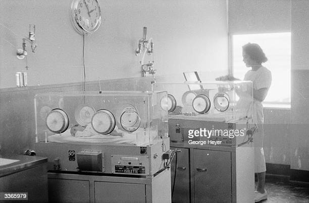 A nurse about to begin feeding in the nursery at Mount Sinai Hospital in New York