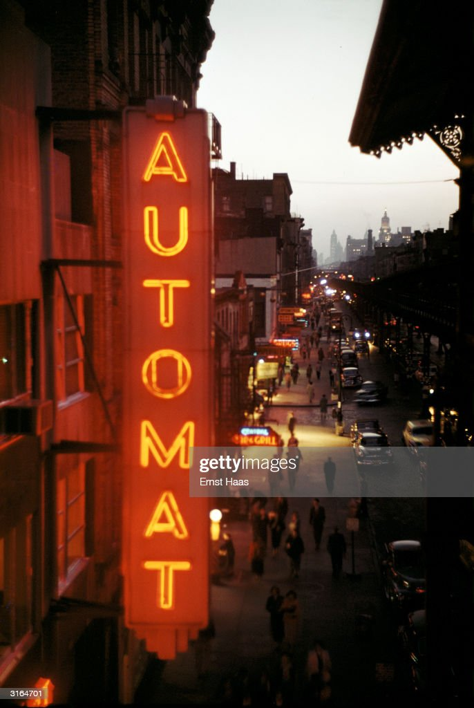 A red neon sign on New York's Third Avenue, advertising an automat.