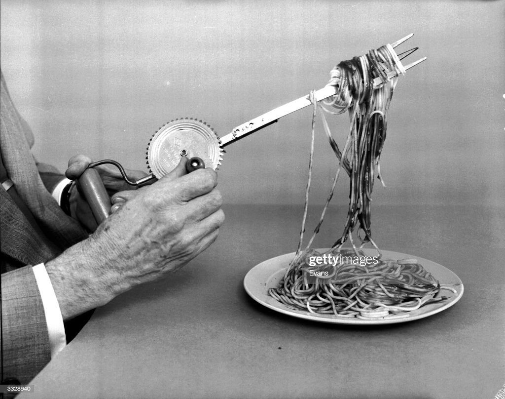 A wind up spaghetti fork in operation. Devised by amateur American inventor Russell E Oakes, the fork winds spaghetti strands making them easy to eat.