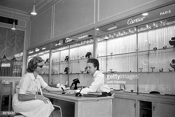 A woman consulting a jeweller in her shop in the Chacaito district of Caracas Venezuela