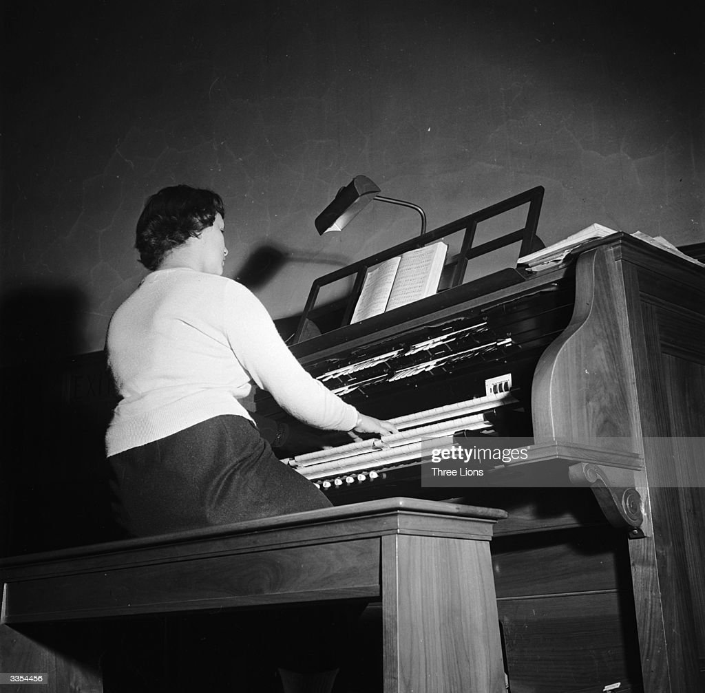A woman playing an organ.