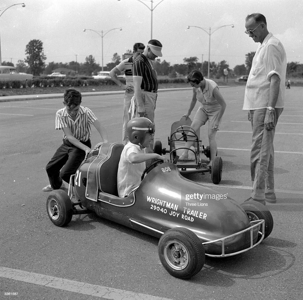 A young competitor getting a push at the end of a 'Grand Prix' which takes place in a parking lot in Livonia Michigan a suburb of Detroit