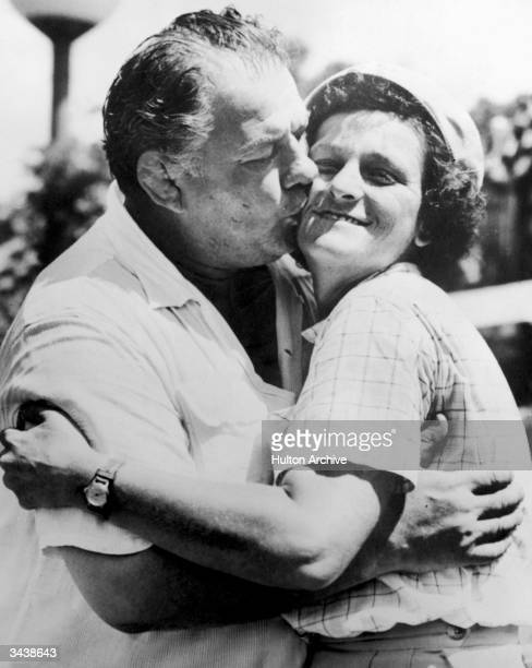 American athlete Mildred 'Babe' Didrikson Zaharias and her husband American wrestler George Zaharias embrace outdoors