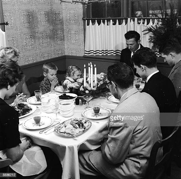 An American family saying Grace before christmas dinner