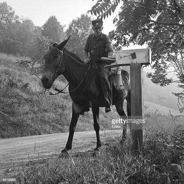 An American postman delivering letters by mule