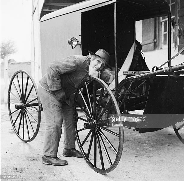 An elderly member of the Amish community in Lancaster County inspecting one of the carts which are their chief mode of transport