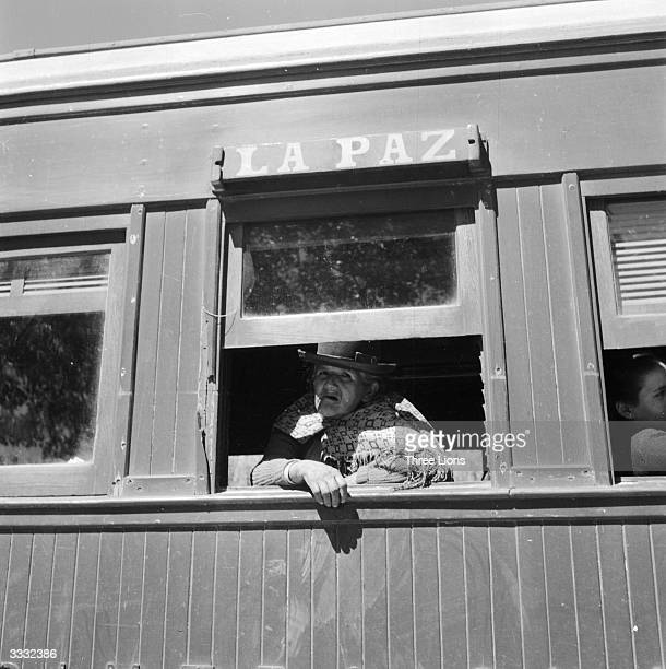 An Indian woman looking through a window of the express train from Villason on the BolivianArgentine border to La Paz